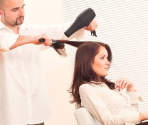 female having her hair blow dried